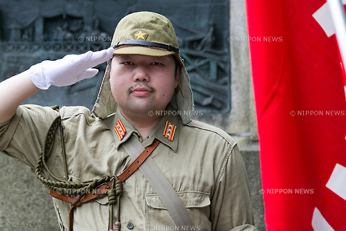 A man wearing a WW2 militar uniform poses for the cameras before entering Yasukuni Shrine on the 71st anniversary of Japan's surrender in World War II on August 15, 2016, Tokyo, Japan. Some 70 lawmakers visited the Shrine to pay their respects, but the Prime Minister Shinzo Abe did not visit the controversial symbol and instead sent a ritual offering to a shrine. Yasukuni enshrines the war dead including war criminals and as such visits by Japanese  politicians tend to provoke anger from neighbors China and Korea that suffered from Japan's militarist past. (Photo by Rodrigo Reyes Marin/AFLO)