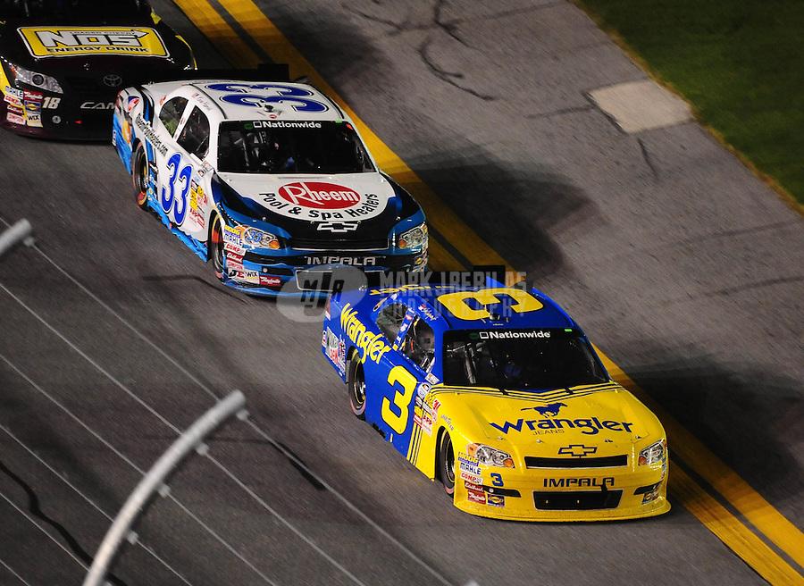 Jul. 2, 2010; Daytona Beach, FL, USA; NASCAR Nationwide Series driver Dale Earnhardt Jr. (3) leads Kevin Harvick during the Subway Jalapeno 250 at Daytona International Speedway. Mandatory Credit: Mark J. Rebilas-
