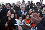 Palestinian Prime Minister Salam Fayyad takes part during a Christmas parade in the West Bank city of Bethlehem on 23 December 2010. Scores of Christian pilgrims are preparing to gather in the traditional birthplace of Jesus Christ in the West Bank to celebrate Christmas on December 25. Photo by Najeh Hashlamoun