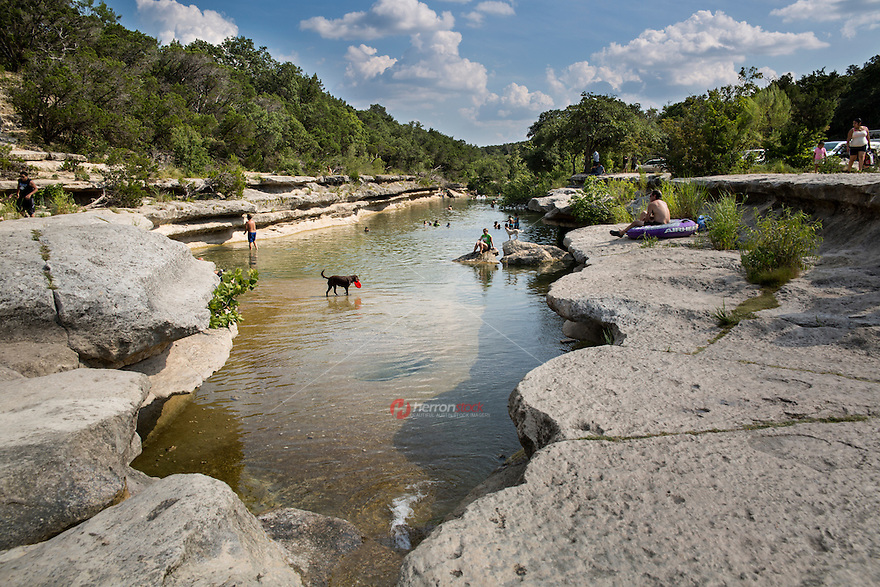 The Lower Bull Creek Greenbelt extends from the northern trail entrance at Old Spicewood Springs road on the east side of Loop 360 (next to the Treetops Apartments) to the Bull Creek District Park on Lakewood Drive. Inset, one of the many limestone waterfalls and popular swimming holes along Bull Creek.