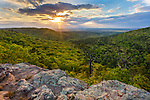 Petit Jean State Park, AR: Sunset at Palisades Overlook with lichen covered sandstone and spring forest