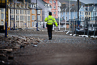 Monday 06 January 2014<br /> Pictured: Police clear the promenade asThe Sea batters Aberystwyth Seafront<br /> Re: Storm force winds and high tides hit the UK