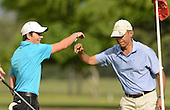 United States President Barack Obama fist bumps Max Key, son of the Prime Minister John Key of New Zealand, on the 2nd green at Marine Corps Base Hawaii's Kaneohe Klipper Golf Course  Kaneohe, Hawaii January 2, 2014.<br /> Credit: Cory Lum / Pool via CNP