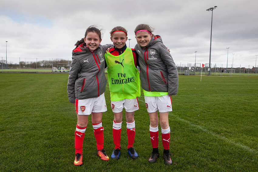 Left to right. Olivia Bartlett, Laila Harbert and  Rinini Lowe, all age 10. Arsenal Ladies Under 10 and AC Finchley boys team play a football game at Univeristy of Hertfordshire's campus sports village  football pitch in Hatfield.