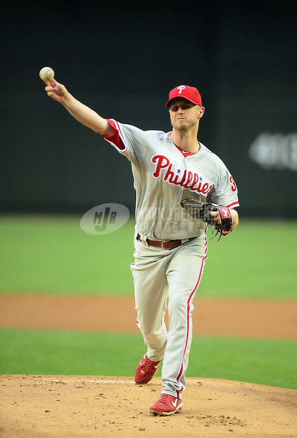 Apr. 23, 2012; Phoenix, AZ, USA; Philadelphia Phillies pitcher Kyle Kendrick throws in the first inning against the Arizona Diamondbacks at Chase Field. Mandatory Credit: Mark J. Rebilas-