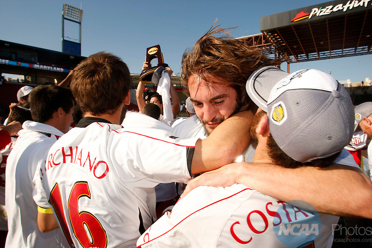 14 DEC 2008:  Michael Marchiano (16), Drew Yates (12) and Rich Costanzo (6) of the University of Maryland celebrate their victory over the University of North Carolina during the Division I Men's Soccer Championship held at Pizza Hut Park in Frisco, TX.  Maryland defeated North Carolina 1-0 for the national title.  Jamie Schwaberow/NCAA Photos