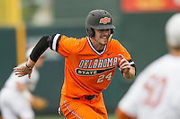 Oklahoma State Cowboys outfielder Conor Costello #24 runs to third base during the NCAA baseball game against the Texas Longhorns on April 26, 2014 at UFCU Disch–Falk Field in Austin, Texas. The Cowboys defeated the Longhorns 2-1. (Andrew Woolley/Four Seam Images)