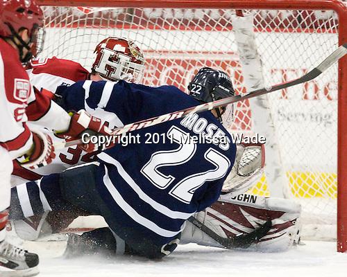 Steve Michalek (Harvard - 34), Stevie Moses (UNH - 22) - The Harvard University Crimson defeated the University of New Hampshire Wildcats 7-6 on Tuesday, November 22, 2011, at Bright Hockey Center in Cambridge, Massachusetts.