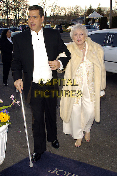 FRANK BASILE & CELESTE HOLM.Recipient of the Lifetime Achievement Award for Acting. .The fifth annual Garden State Film Festival awards dinner at The English Manor, Ocean, New Jersey, USA..March 25th, 2007.full length black white cream dress coat fur arms linked gloves walking cane.CAP/ADM/BL.©Bill Lyons/AdMedia/Capital Pictures *** Local Caption ***