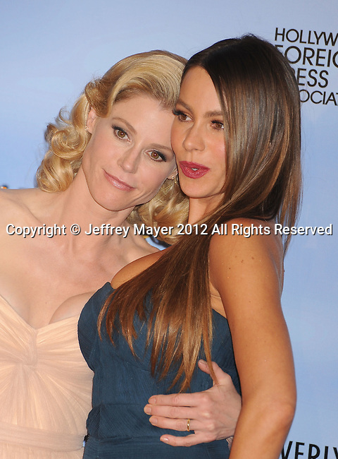 BEVERLY HILLS, CA - JANUARY 15: Julie Bowen and Sofia Vergara pose in the press room at the 69th Annual Golden Globe Awards held at the Beverly Hilton Hotel on January 15, 2012 in Beverly Hills, California.