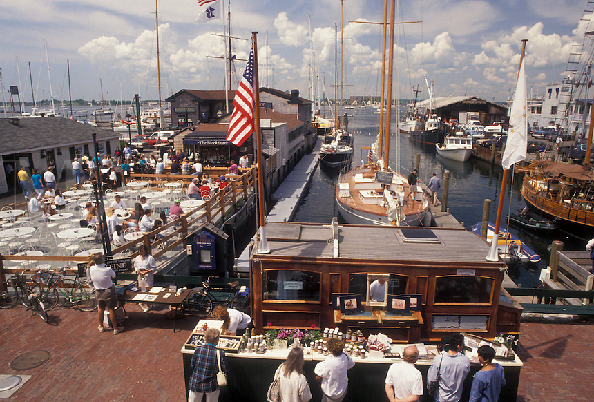 AJ4414, Newport, Newport Harbor, Rhode Island, People enjoying a sunny day on Sayer's Wharf in The Mooring at Newport's colonial seaport in the state of Rhode Island.