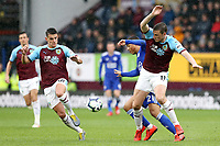 Leicester City's Youri Tielemans vies for possession with Burnley's Ashley Westwood (left) and Chris Wood <br /> <br /> Photographer Rich Linley/CameraSport<br /> <br /> The Premier League - Burnley v Leicester City - Saturday 16th March 2019 - Turf Moor - Burnley<br /> <br /> World Copyright © 2019 CameraSport. All rights reserved. 43 Linden Ave. Countesthorpe. Leicester. England. LE8 5PG - Tel: +44 (0) 116 277 4147 - admin@camerasport.com - www.camerasport.com