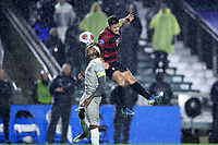 CARY, NC - DECEMBER 13: Logan Panchot #22 of Stanford University and Ifunanyachi Achara #20 of Georgetown University challenge for a header during a game between Stanford and Georgetown at Sahlen's Stadium at WakeMed Soccer Park on December 13, 2019 in Cary, North Carolina.