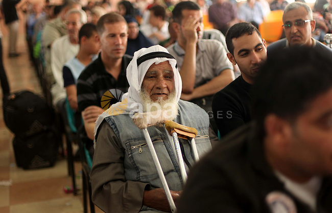 Palestinians gather at the Rafah border crossing in the southern Gaza Strip, as they await permission to enter Egypt on June 14, 2015. Egypt is due to reopen its Rafah border crossing with Gaza for three days. The Rafah crossing point between Egypt and the Gaza Strip will open three days from Saturday to allow entry and exit of Gazan patients and students, Palestinian and Egyptian officials said. Photo by Ashraf amra