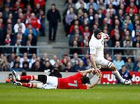 Photo: Richard Lane/Richard Lane Photography. England v Wales. 25/02/2012. England's Ben Morgan is tackled by Wales' Sam Warburton.