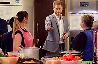 14 May 2019 - Prince Harry Duke of Sussex, tours the kitchen as he visits the community cafe during a visit to Barton Neighbourhood Centre in Oxford. The centre is a hub for local residents which houses a doctor's surgery, food bank, cafe and youth club. Photo Credit: ALPR/AdMedia