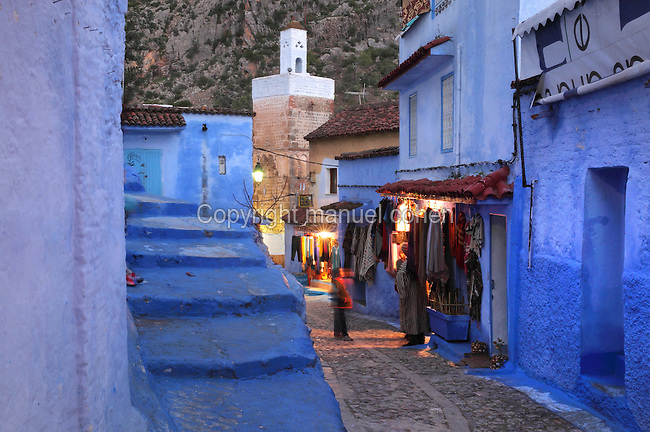 Shops in a street in the medina or old town of Chefchaouen in the Rif mountains of North West Morocco. Chefchaouen was founded in 1471 by Moulay Ali Ben Moussa Ben Rashid El Alami to house the muslims expelled from Andalusia. It is famous for its blue painted houses, originated by the Jewish community, and is listed by UNESCO under the Intangible Cultural Heritage of Humanity. Picture by Manuel Cohen