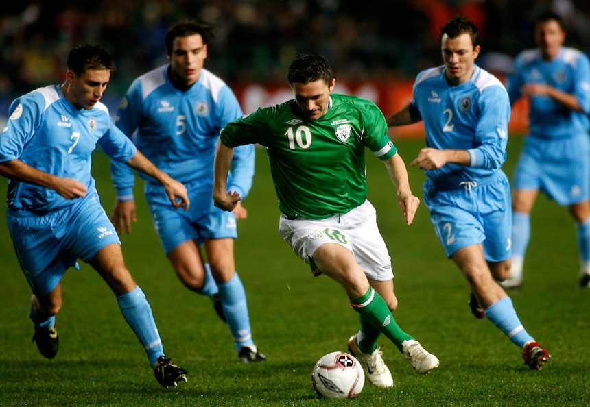 "Ireland's Robbie Keane faces a heavy defense from the San Mario soccer team. Expectations for national team sports runs high, as many supporters expect them to ""punch above its own weight"" - and win. Old Gaelic sports compete now with soccer and ruby for the nation's attention, and in this sport-mad country, even stadiums get caught up in history. Ireland's rugby team played England at Croke Park this year, the first time at the hallowed Gaelic sport stadium since the Bloody Sunday massacre in 1920."
