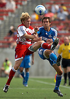 FC Dallas' Bobby Rhine (19) battles KC Wizards' Davy Arnaud (22) for the ball at Pizza Hut Park on Sunday April 23, 2006. Dallas beat Kansas City 2-1.