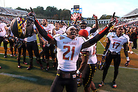 Maryland Terrapins defensive back Sean Davis (21) celebrates the win with teammates during the game against Virginia in Charlottesville, Va. Maryland defeated Virginia 27-20.