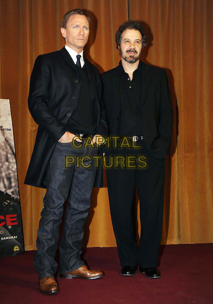 "DANIEL CRAIG & EDWARD ZWICK .""Defiance"" Photocall held at the Hotel St. Regis, Rome, Italy, 19th January 2009. .full length black suit jeans navy  blue coat brown shoes tie .CAP/ADM/LIV.©Liverani/Admedia/Capital PIctures"