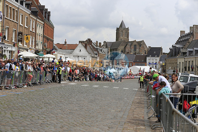 Fans wait for the race to pass through the ancient town of Cassel during Stage 4 of the 2014 Tour de France running 163.5km from Le Touquet to Lille. 8th July 2014.<br /> Picture: Eoin Clarke www.newsfile.ie