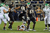 1 September 2011:  FIU linebacker Gregory Hickman (55), defensive tackle Joshua Forney (96) and defensive end Tourek Williams celebrate Hickman's quarterback sack in the second half as the FIU Golden Panthers defeated the University of North Texas, 41-16, at FIU Stadium in Miami, Florida.