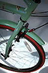 "[DENVER, CO   6/2/04] The front wheel of the Bianchi Milano (cq) in the color ""celeste"", one of the cruiser bicycles at Turin Bicycles at 700 Lincoln St. in Denver.   .(Photo by ELLEN JASKOL/ROCKY MOUNTAIN NEWS)"