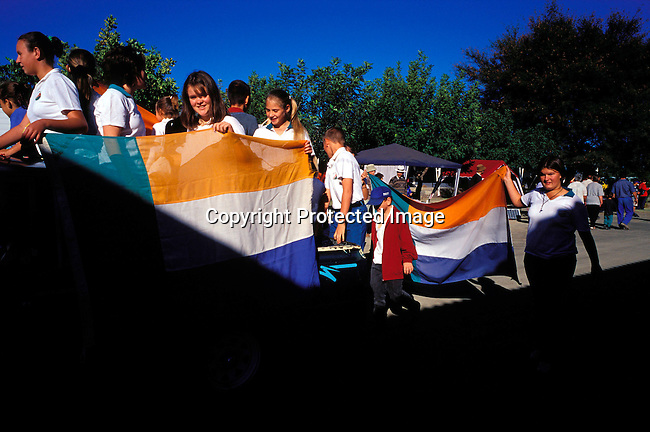 DIPOAFR00052.Culture Afrikaners School children from Orania carrying an old SA flag and the Transvaal flag at the Orania Show, a yearly happening in this all white Afrikaner community in Northern Cape , South Africa..Photo: Per-Anders Pettersson/ iAfrika Photos