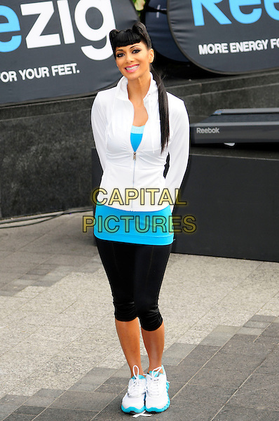NICOLE SCHERZINGER.Nicole Scherzinger launches Reebok's revolutionary new ZigTech trainer, Westfield Shopping Centre, London, England..29th November 2010.FULL length blue turquoise tops shorts leggings white hair coif quiff ponytail.CAP/CAS.©Bob Cass/Capital Pictures.