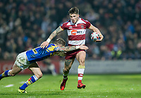 Picture by Allan McKenzie/SWpix.com - 13/04/2018 - Rugby League - Betfred Super League - Leeds Rhinos v Wigan Warriors - Headingley Carnegie Stadium, Leeds, England - Wigan's John Bateman is tackled by Leeds's Matt Parcell.
