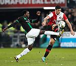 Nederland, Rotterdam, 23 december  2012.Eredivisie.Seizoen 2012/2013.Feyenoord-FC Groningen.Graziano Pelle van Feyenoord in duel om de bal met Oluwafemi Ajilore van FC Groningen
