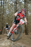 07 APR 2007 - THETFORD, UK - A competitor makes his way through a wooded section during round 1 of the British Mountain Bike X Country series. (PHOTO (C) NIGEL FARROW)