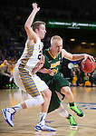SIOUX FALLS, SD - MARCH 10: A. J. Jacobson #21 of North Dakota State drives against Reed Tellinghuisen #23 of South Dakota State in the first half of the Summit League Championship Tournament game Tuesday at the Denny Sanford Premier Center in Sioux Falls, SD. (Photo by Dick Carlson/Inertia)