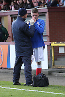 Adam Wilson gets treatment to a nose injury in the Celtic v Rangers City of Glasgow Cup Final match played at Firhill Stadium, Glasgow on 29.4.13,  organised by the Glasgow Football Association and sponsored by City Refrigeration Holdings Ltd.