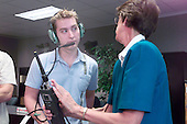 Carolynn Conley gives HAM radio instructions to Soyuz 5 Nominated Space Flight Participant Lance Bass, a member of the pop singing group 'N Sync, as part of the Soyuz 5 crew's training and familiarization tour on August 27, 2002 at the Lyndon B. Johnson Space Center in Houston, Texas. .Credit: NASA via CNP