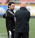 Alloa boss Paul Hartley chats to United boss Peter Houston before the game.