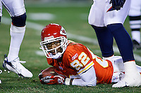 Dante Hall looks up from the ground after the Denver Broncos held him to zero yards on a punt return in the second quarter at Arrowhead Stadium in Kansas City, Missouri on November 23, 2006. The Chiefs won 19-10.