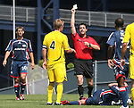 17 June 2007: Referee Niko Bratsis (in red) shows a yellow card to Columbus's Rusty Pierce (4) as New England's Ryan Solle (30) and Arsene Oka (CIV) (r) watch. The New England Revolution Reserves defeated the Columbus Crew Reserves 2-1 on the Gillette Stadium practice field in Foxboro, Massachusetts in a Major League Soccer Reserve Division game.