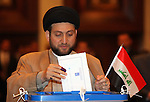 BAGHDAD, IRAQ:  Amar Abdul Aziz Hakim, leader of the  Islamic Supreme Council of Iraq votes...On March 7th, 2010, Iraq held nationwide parliamentary elections.