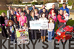 David Flynn Memorial Poker Run: Mary Doyle from the Listowel, North Kerry M.S. Branch accepting a cheque last Sunday for EUR23,041 from the David Flynn Memorial Poker Run which was held in September.
