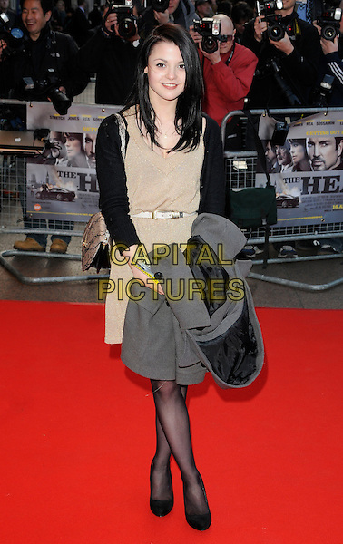 KATHRYN PRESCOTT.World Premiere of 'The Heavy' at the Odeon West End, Leicester Square, London, England, UK..April 15th 2010 .full length katherine catherine beige sleeveless dress black sleeves white belt carrying grey gray.CAP/CAN.©Can Nguyen/Capital Pictures.