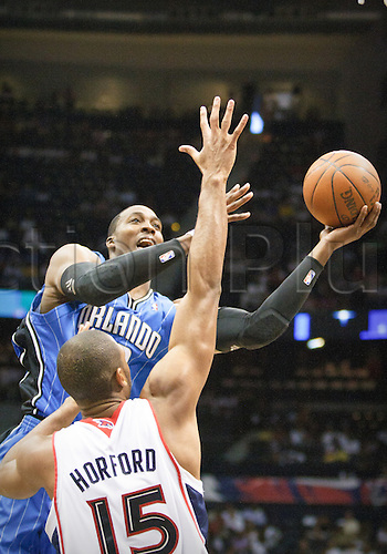 08 May 2010: Orlando's Dwight Howard is being defended by Atlanta's Al Horford (15) in Eastern Conference Semi-Finals Atlanta Hawks 105-75 loss to the Orlando Magic in Game 3 at Philips Arena in Atlanta, GA.