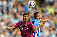 Kyle Walker of Manchester City (2) and Tomer Hemed of Brighton & Hove Albion (10) challenge for the ball  during the EPL - Premier League match between Brighton and Hove Albion and Manchester City at the American Express Community Stadium, Brighton and Hove, England on 12 August 2017. Photo by Edward Thomas / PRiME Media Images.