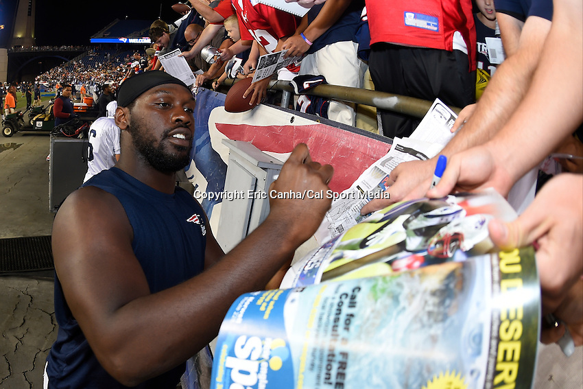 August 5, 2015: New England Patriots defensive end Chandler Jones (95) signs gives a fan an autograph during the New England Patriots training camp held on the the game field at Gillette Stadium in Foxborough Massachusetts. Eric Canha/CSM
