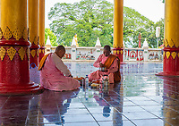 Kyauktaw Mahamuni Temple, Rakhine State, Myanmar, Burma Buddhist Nuns having their Lunch break