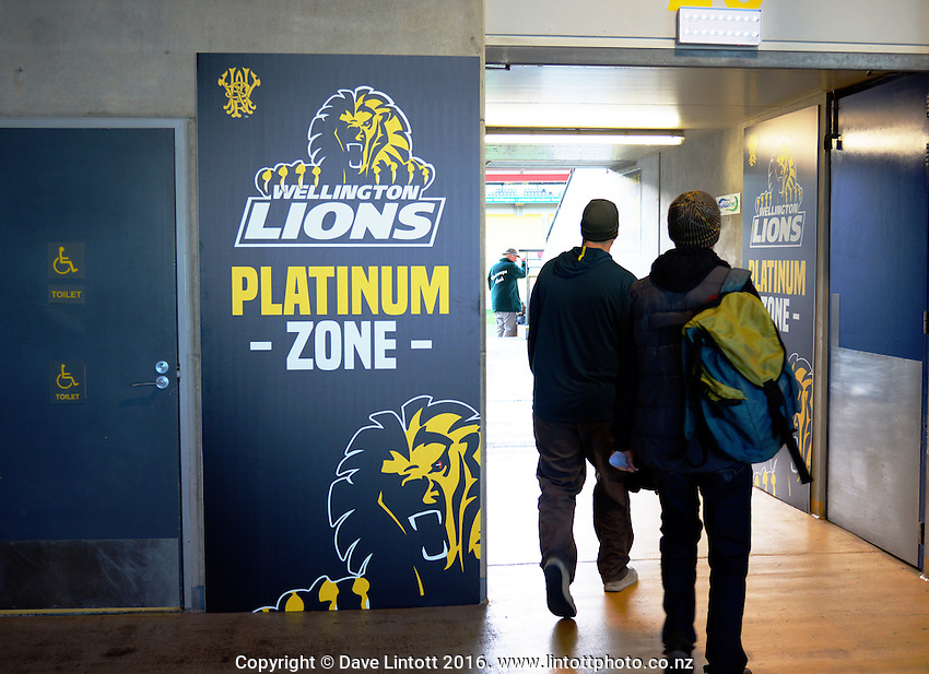 Fans walk to their seats during the Mitre 10 Cup rugby union match between Wellington Lions and North Harbour at Westpac Stadium, Wellington, New Zealand on Saturday, 3 September 2016. Photo: Dave Lintott / lintottphoto.co.nz