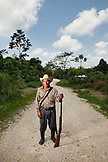 BELIZE, Punta Gorda, Toledo District, farmer Feliz Choc stands in the road on his way to San Jose Maya Village, he uses his gun to protect his crops from the White Lipped Picare, wild pig