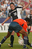 Goalkeeper Briana Scurry of the Atlanta Beat denies Rachel Hoffman of the New York Power on her way to a 2-0 shut out during their June 9th game at Mitchel Athletic Complex.  Scurry has three straight shut outs.