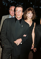 ARCHIVE: CANNES, FRANCE. c. May 1991: Sylvester Stallone & Jennifer Flavin at the Cannes Film Festival.<br /> File photo © Paul Smith/Featureflash